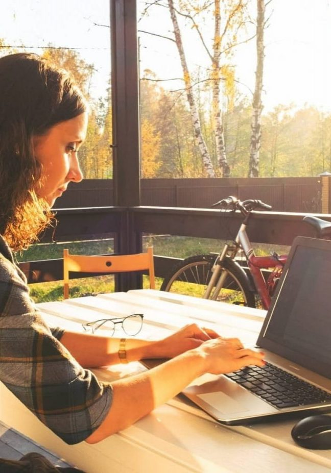 young-businesswoman-working-on-laptop-from-home-office-freelance-woman-using-mobile-technologies_1-min-min